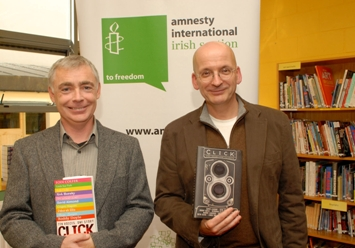Eoin Colfer (left) and Roddy Doyle with the British and American editions of  Click