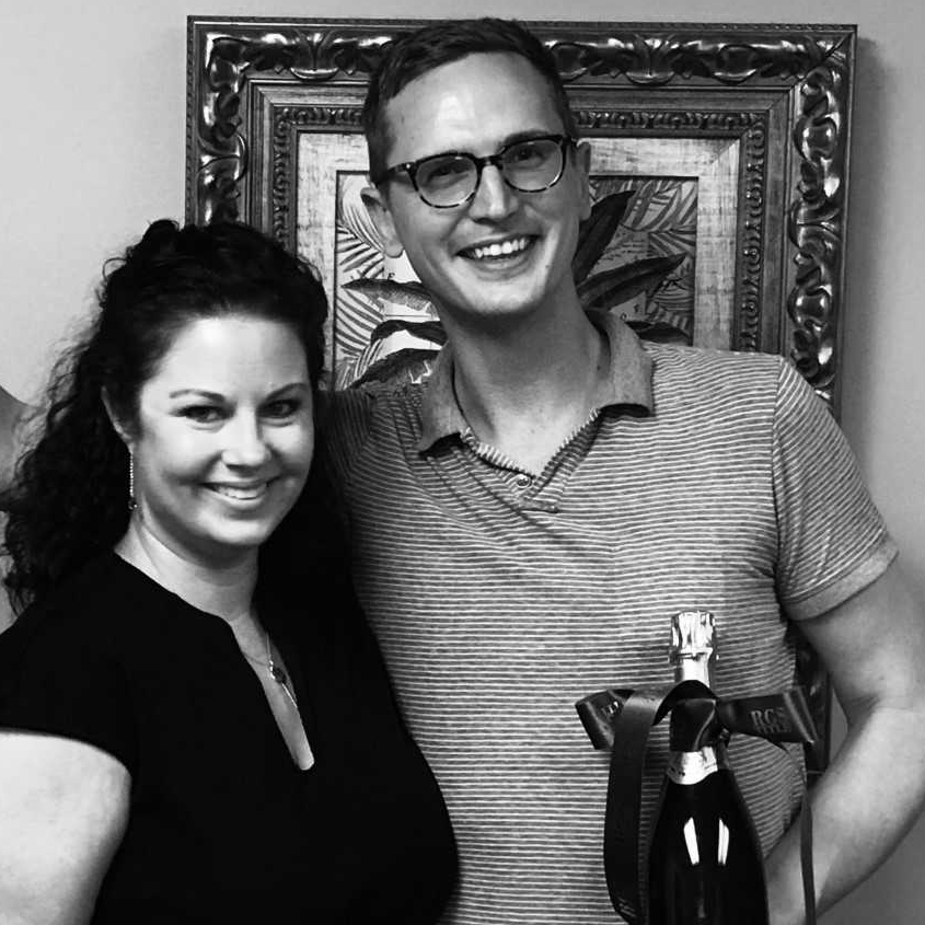 Alex Held celebrates with his realtor, Erin Mendenhall, at the closing of his home in Columbia Forest.