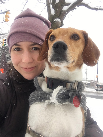 Carolyn Heap and Dash take a walk through Clarendon's snowy streets. Carolyn loves living in a walkable, dog-friendly neighborhood.