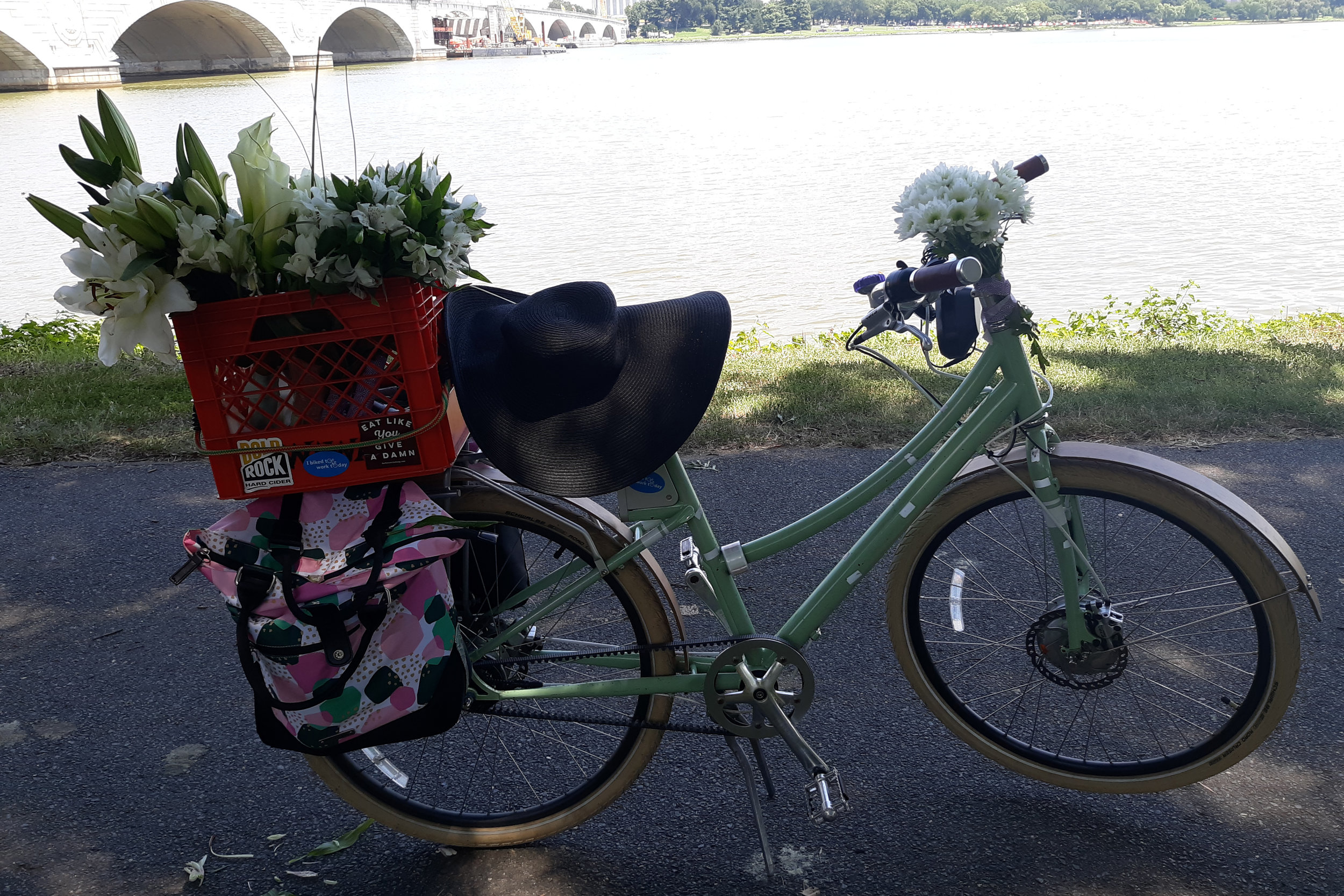Monica Morin's main mode of transportation is her electric bike, on which she hauls groceries and bouquets of flowers.