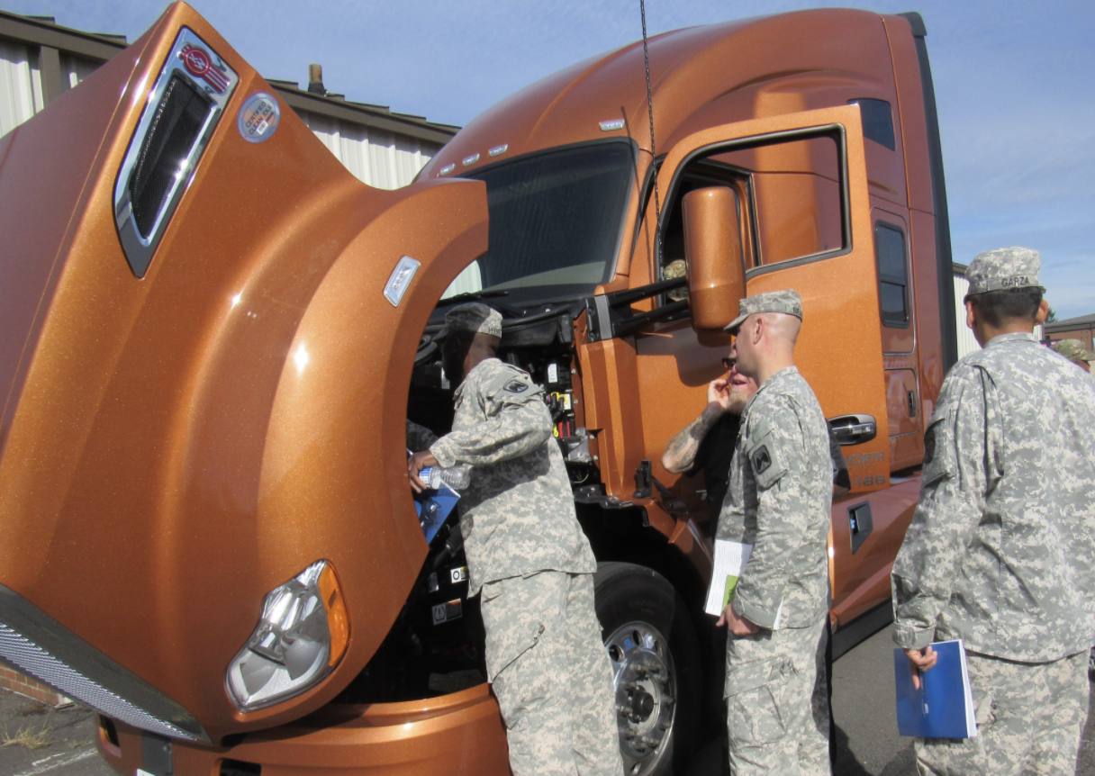 Soldiers at JBLM examining Kenworth T680 truck
