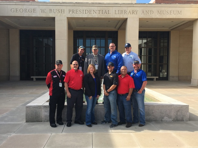 Top 10 Finalists stand outside the George W. Bush Presidential Library and Museum.