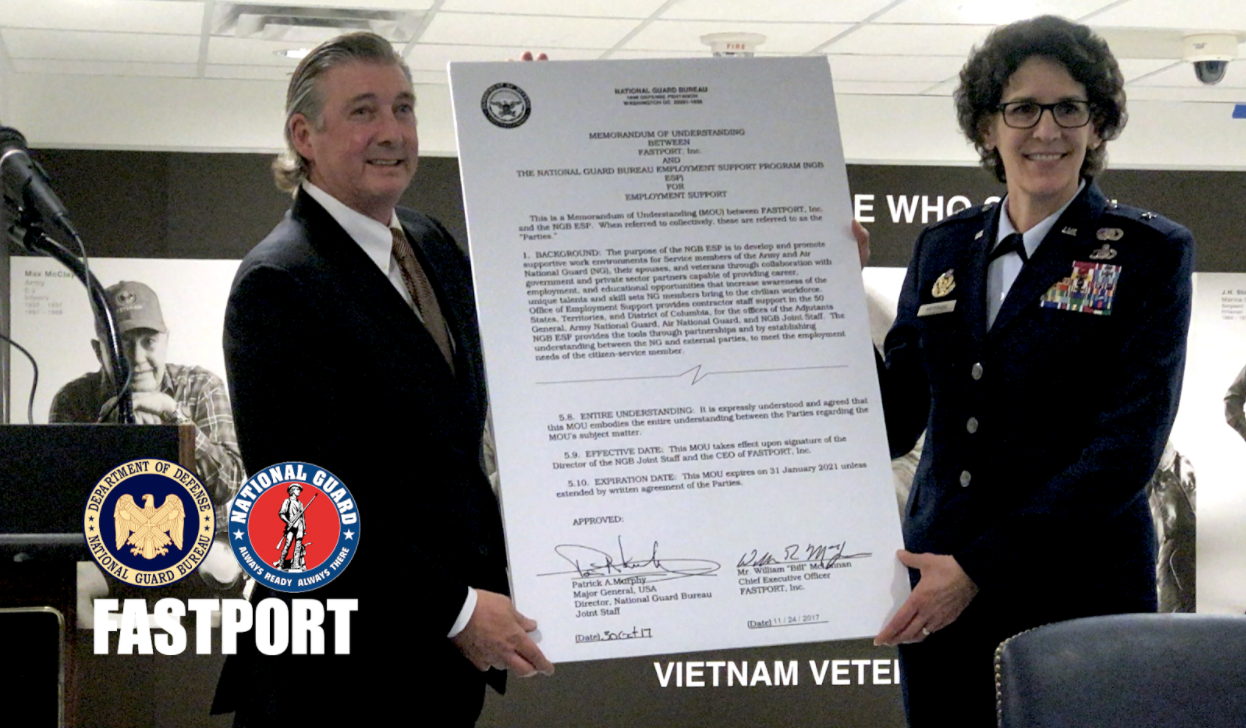 FASTPORT CEO Bill McLennan (left) and Brigadier General Jessica Meyeraan (right) display MOU between the organizations with 29 employers gathered at the Pentagon to sign ESGR Statements of Support.
