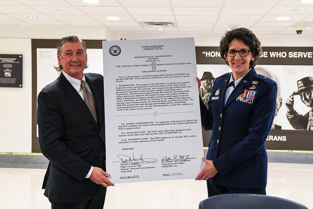 FASTPORT CEO Bill McLennan and Brigadier General Meyeraan hold ceremonial MOU document detailing the partnership between FASTPORT and the National Guard.