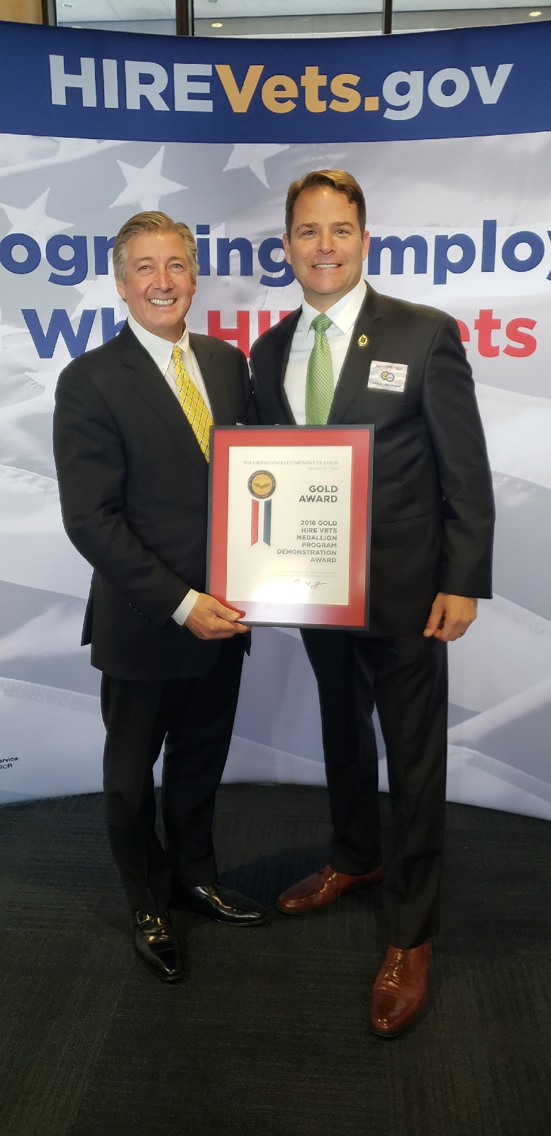 FASTPORT CEO Bill McLennan (left) and VP of Military Engagement Adam Rocke (right) showcase newest award honoring Veteran hiring in American companies.