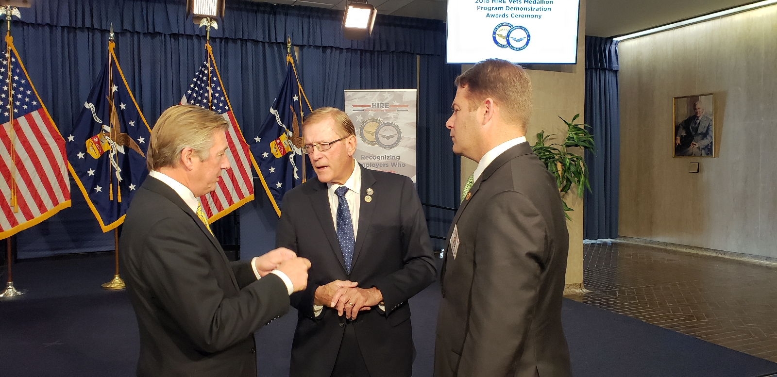 Rep. Paul Cook (R-Apple Valley) (center) discuss the HIRE Vets Award Program and its significance with FASTPORT's leadership present at the U.S. Department of Labor after being awarded the Gold Medallion for Veteran hiring.