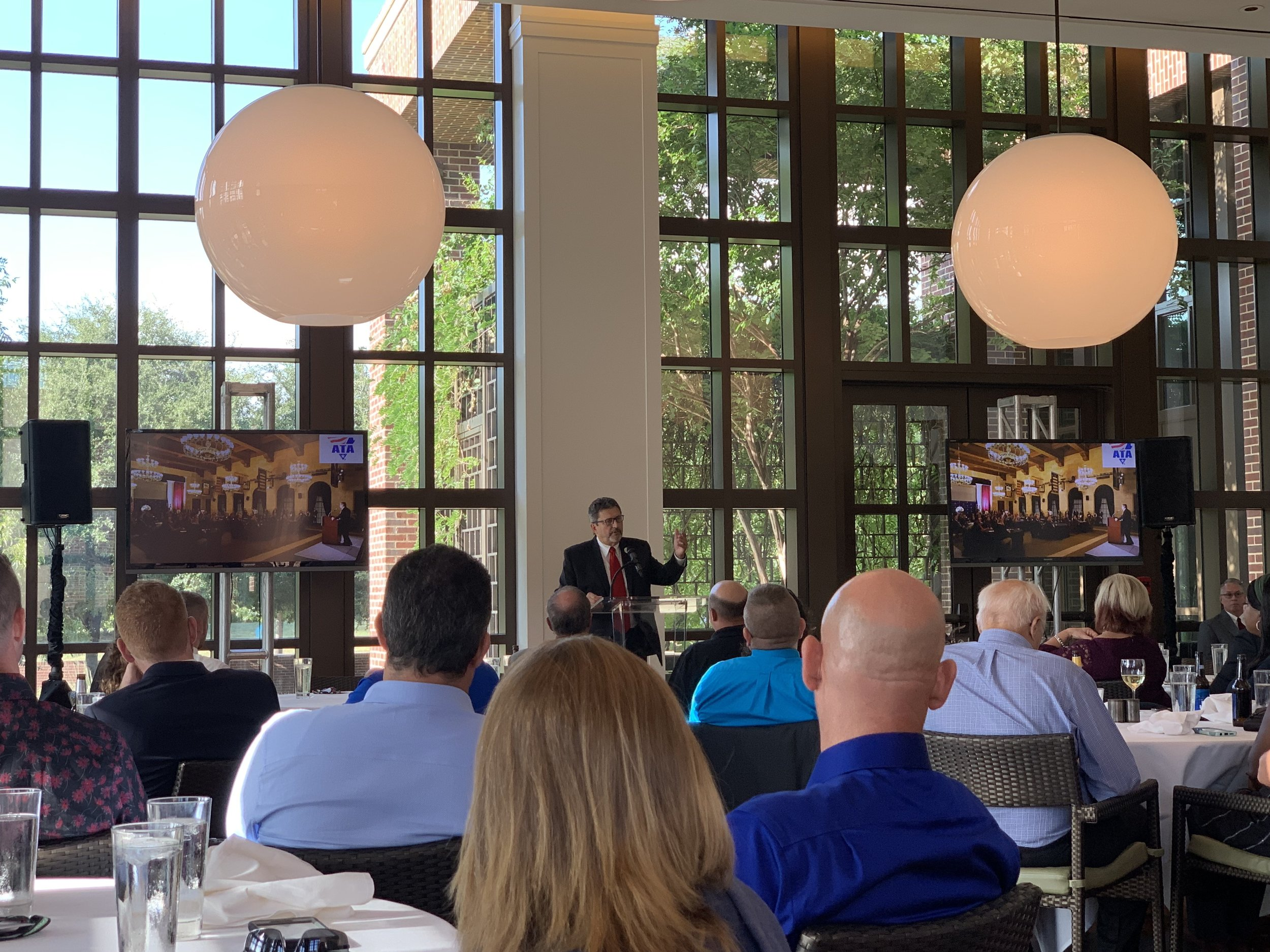 American Trucking Associations Chairman Kevin Burch speaks at the Driver Salute Dinner at the George W. Bush Library and Museum's Cafe 43 where Top 10 finalists were honored.