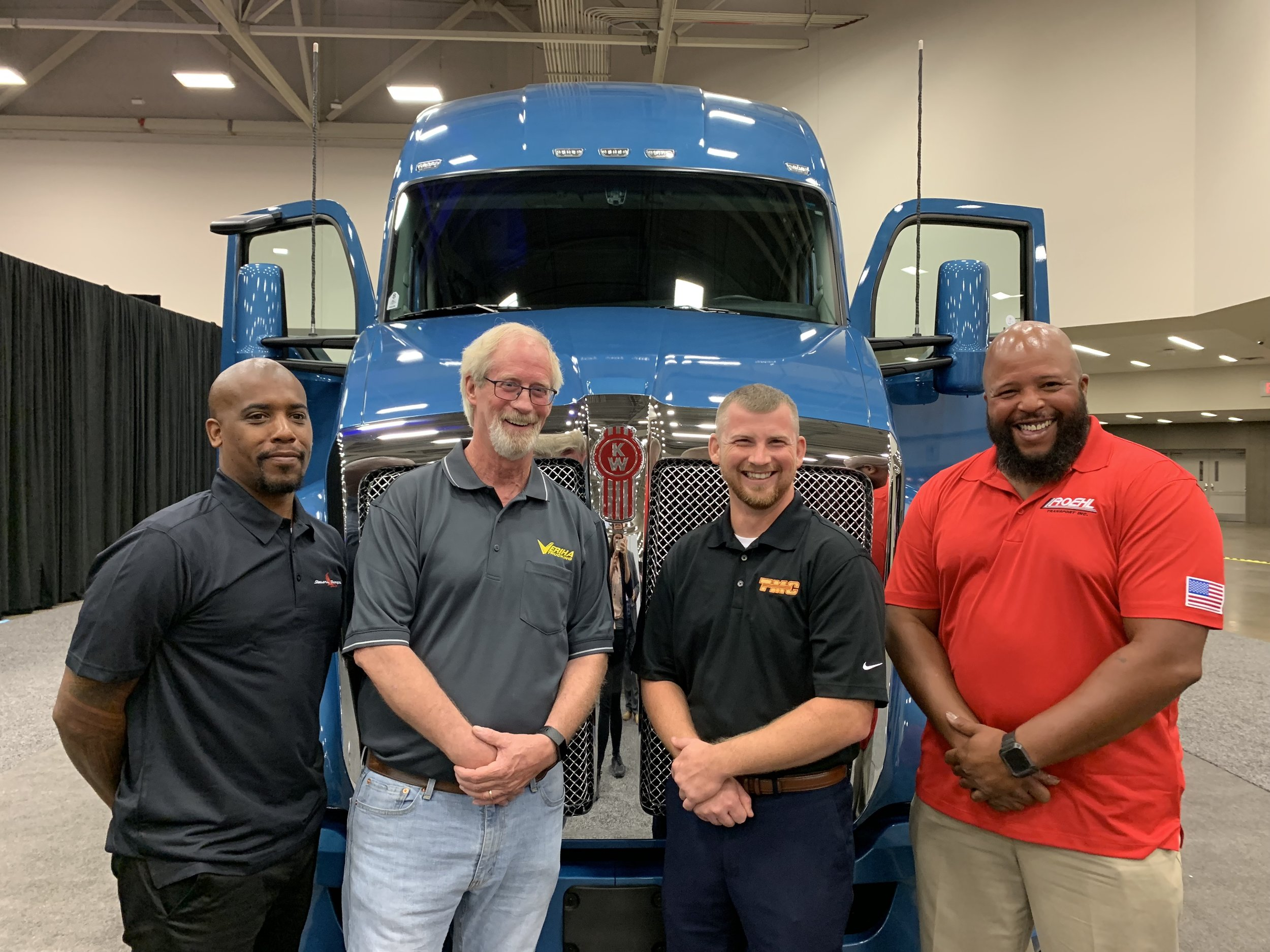Top 4 Finalists in front of Kenworth T680 trucking that will be awarded to the ultimate winner of the Transition Trucking: Driving for Excellence Award. From left to right: Steven Harris, Wade Bumgarner, Christopher Bacon, and Joseph Campbell.