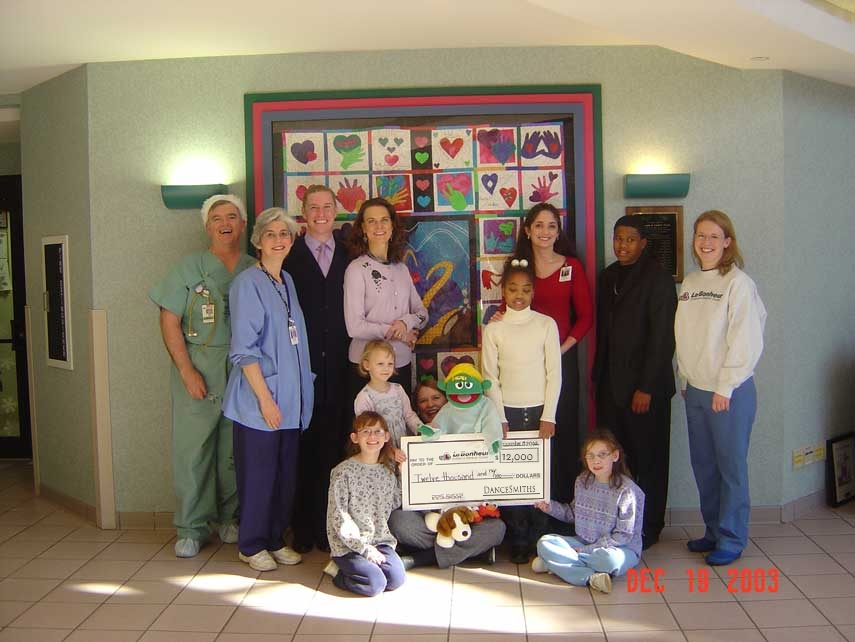 The very first check presentation in 2003. Jack & Karen Tipton. Benji & Beth Smith, and Amy Duffy Graves.