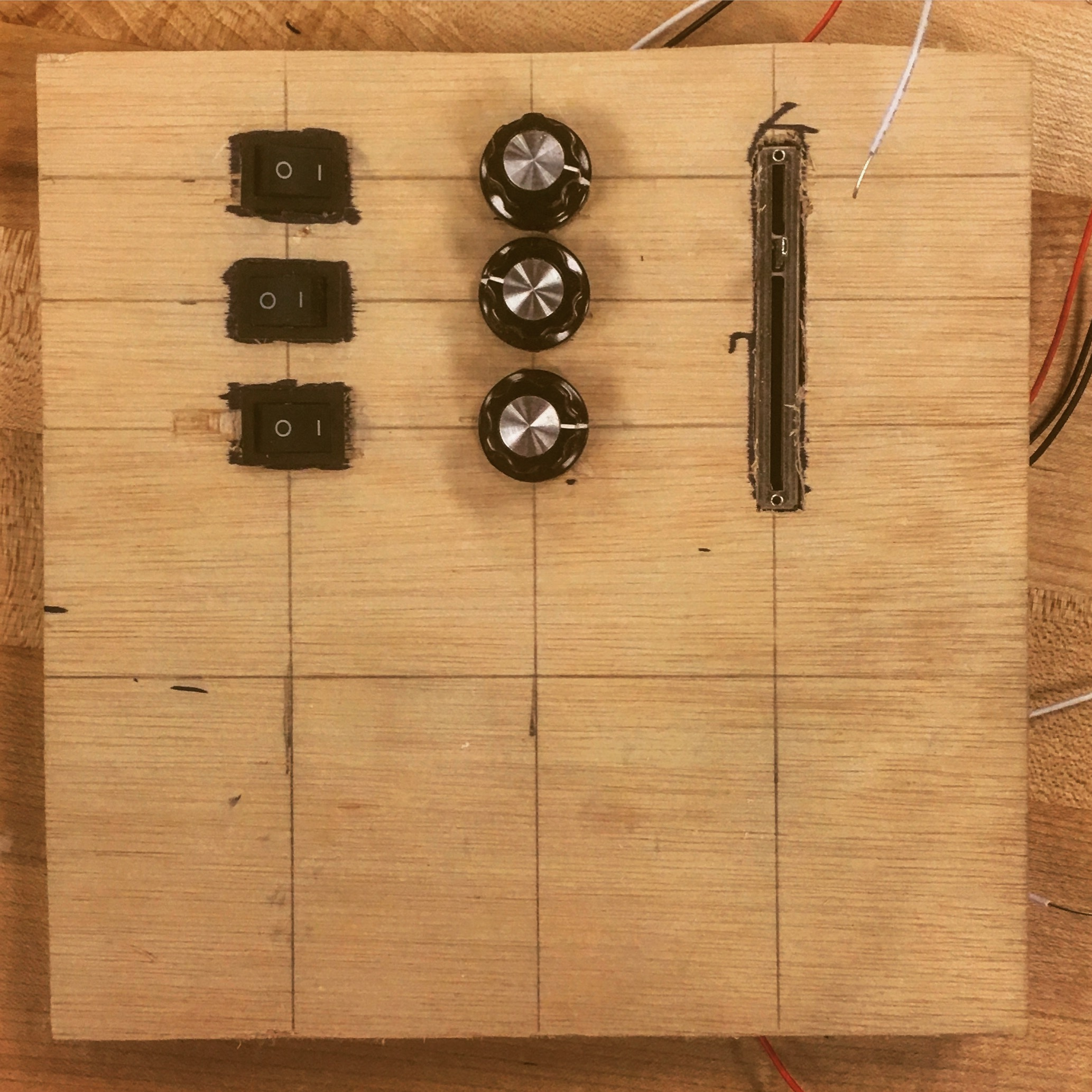 An early build stage of a panel, mapped out controls