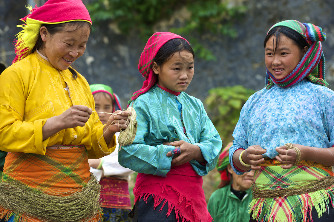 Three young H'Mong girls at the Dong Van market in Vietnam. Image by New Orleans based travel photographer, Marc Pagani