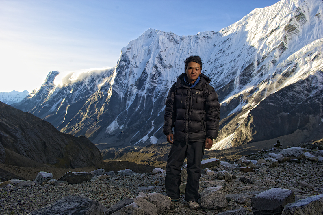 G poses for a photo at Pachermo Base Camp in the Nepal Himalayas.  Image by New Orleans based travel photographer, Marc Pagani