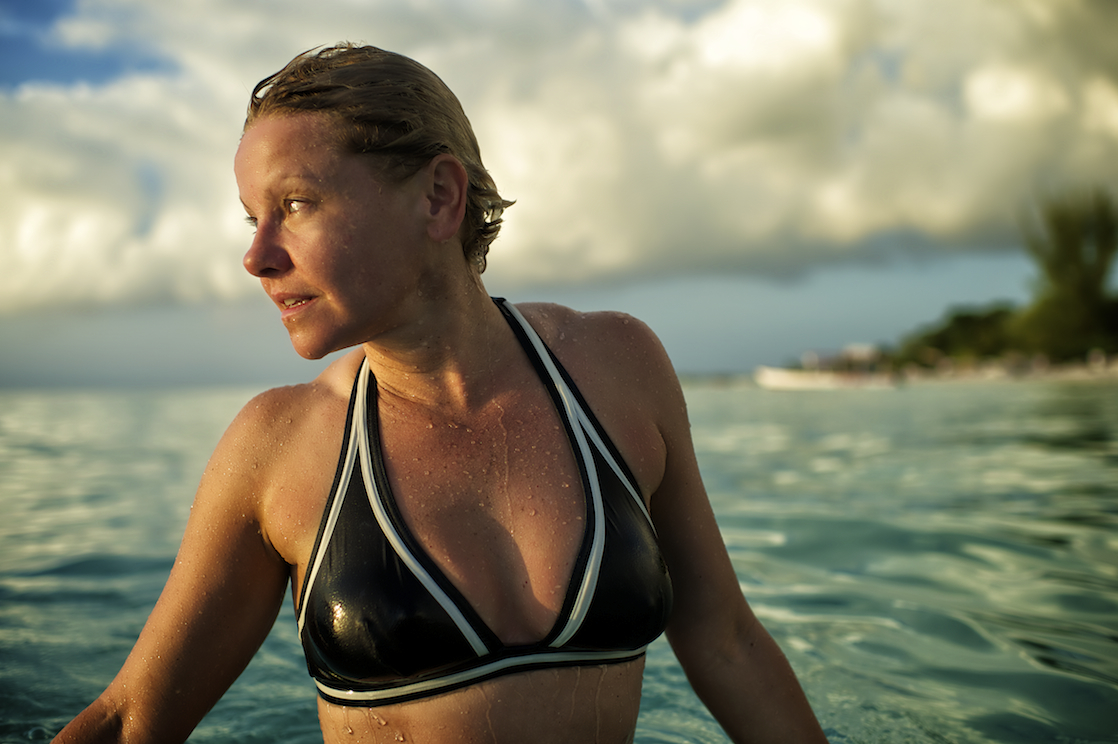 a woman in the ocean in the Dominican Republic.  Image by New Orleans based travel photographer, Marc Pagani