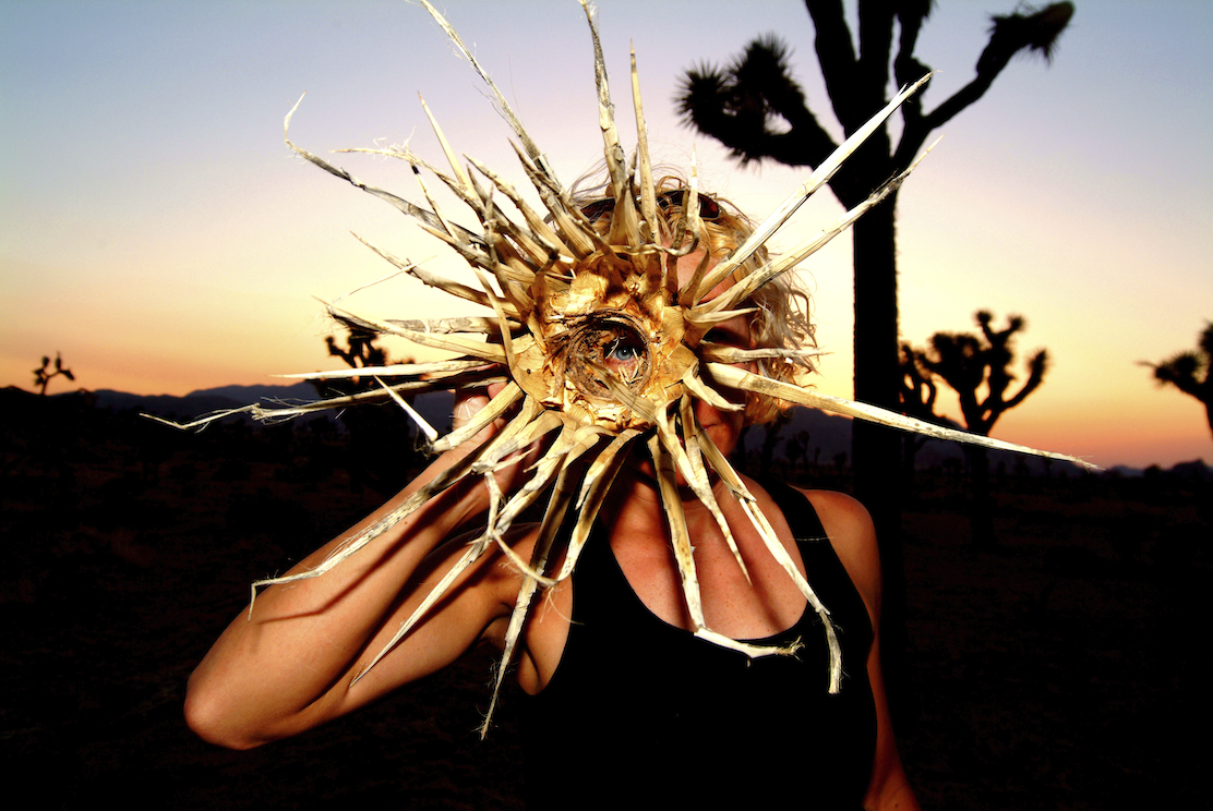 A woman poses at sunset in Joshua Tree, California. Image by New Orleans based travel photographer, Marc Pagani