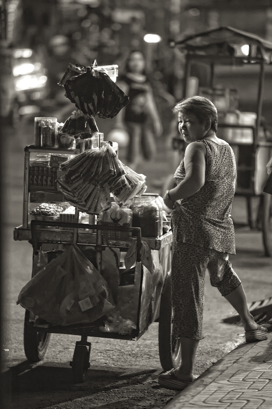 A woman sells dried fish from a cart in Ho Chi Minh City, Vietnam.  Image by New Orleans based travel photographer, Marc Pagani - marcpagani.com