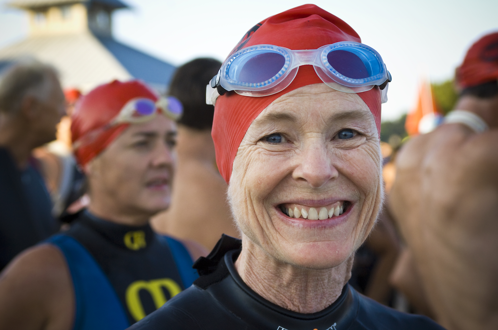 An older female triathlete at a triathlon in Florida, photographed by New Orleans based photographer, Marc Pagani