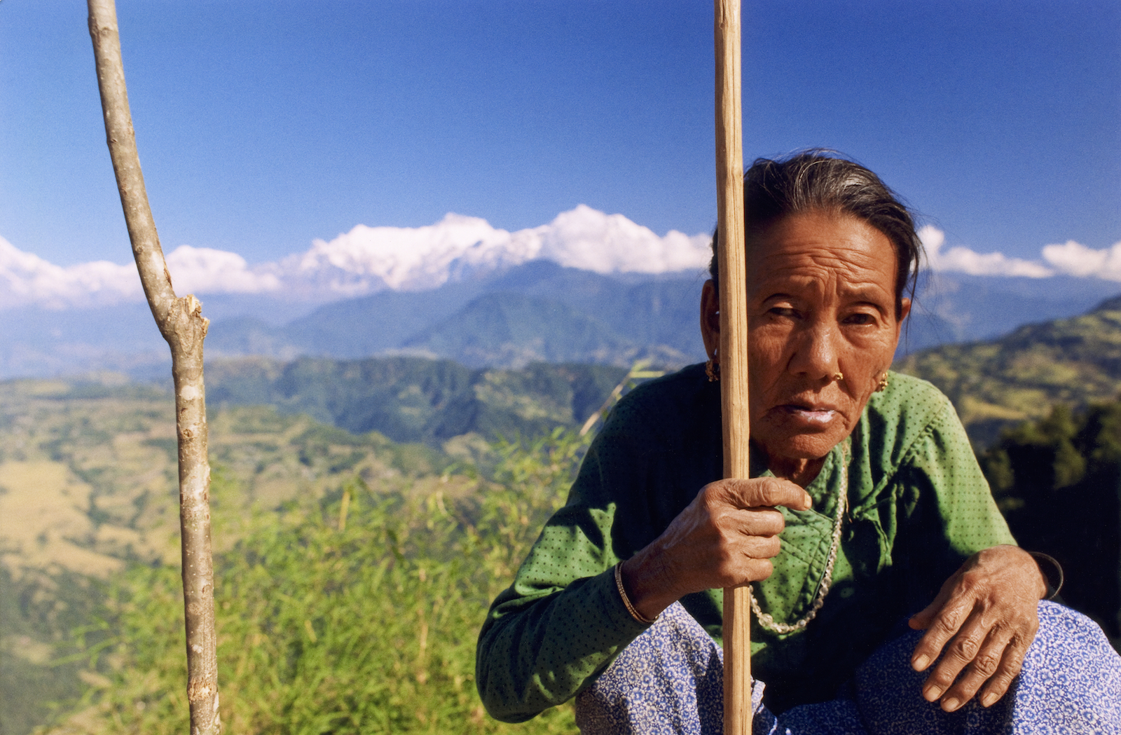 Gurung matriarch on the Royal Trek in Nepal.  Image by New Orleans based travel photographer, Marc Pagani