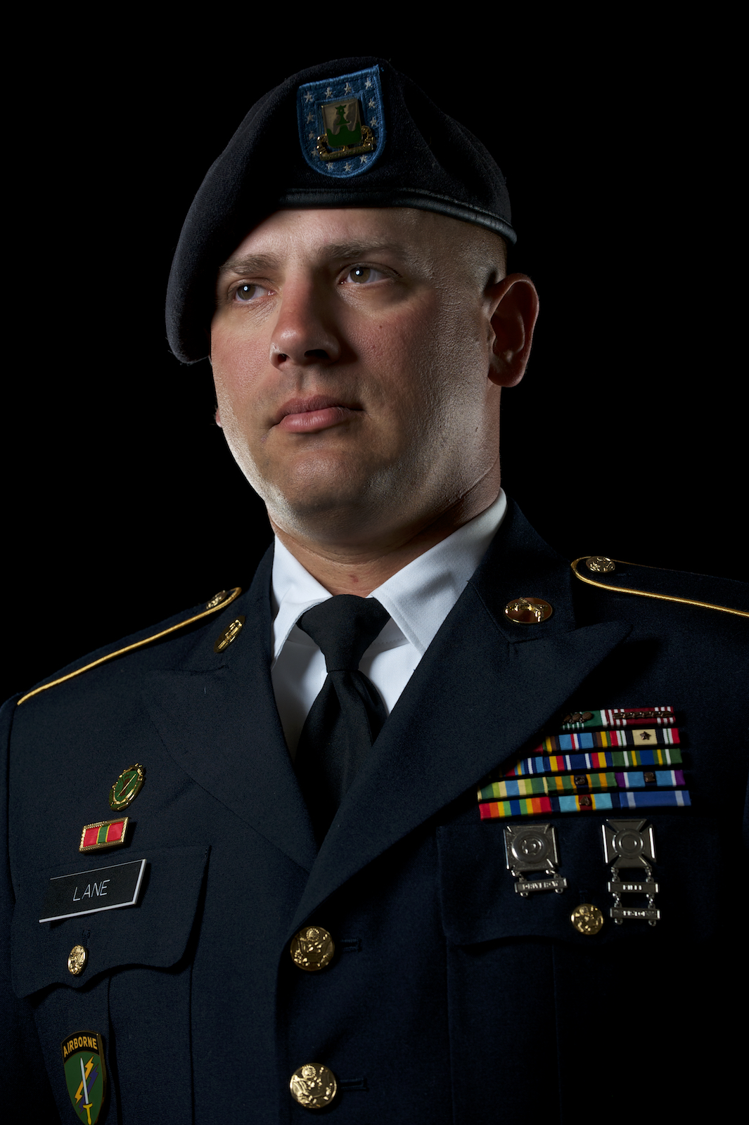 A studio portrait headshot of a soldier in the United States military.  Image by New Orleans based portrait photographer, Marc Pagani