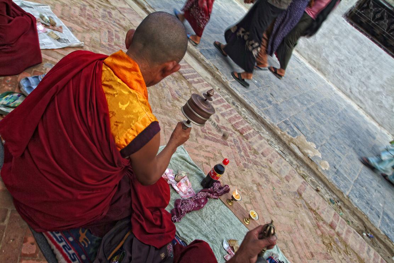Buddhist monks pray near the Boudhanath Temple Stupa in Kathmandu, Nepal.  Image by New Orleans based travel photographer, Marc Pagani - marcpagani.com