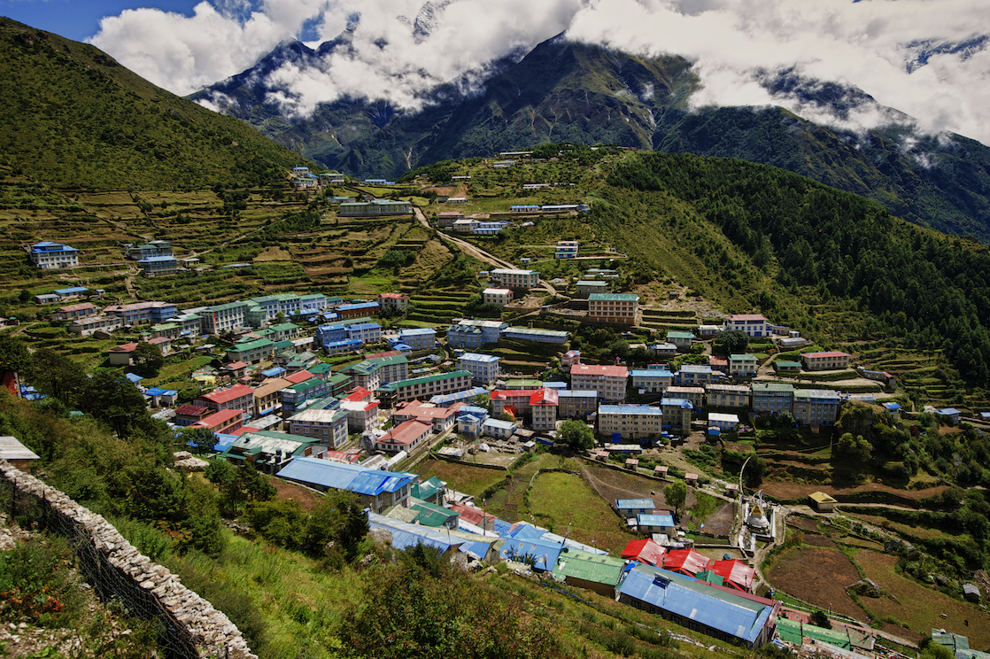 The village of Namche Bazaar in the Nepal Himalayas. Image by New Orleans based travel photographer, Marc Pagani