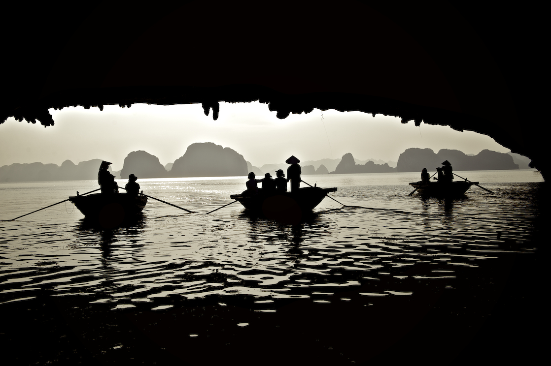 A group of fishermen on the water in Halong Bay, Vietnam.  Image by New Orleans based travel photographer, Marc Pagani