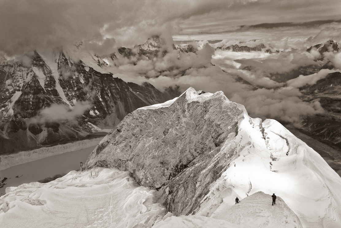 climbers on the way to the summit of Imja Tse or Island Peak in the Nepal, Himalayas. Image by New Orleans based travel photographer, Marc Pagani - marcpagani.com