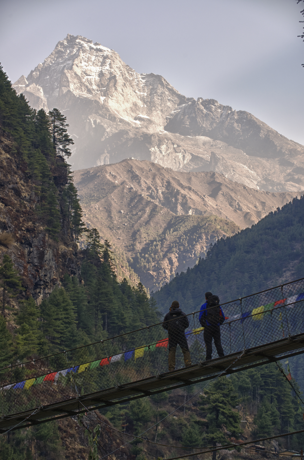 Climbers stop to enjoy the view on the way to Mount Everest base camp in the Nepal Himalayas.  Image by New Orleans based travel photographer, Marc Pagani - marcpagani.com
