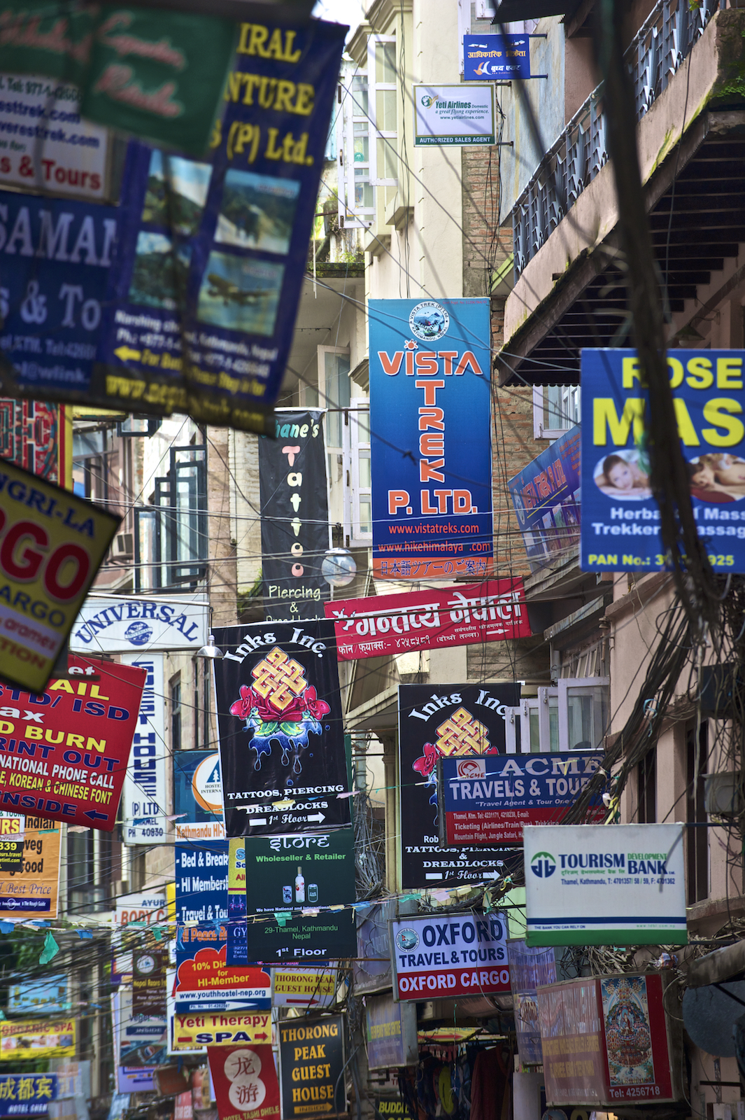 Signs for businesses in Thamel, Kathmandu Nepal.  Image by New Orleans based travel photographer, Marc Pagani - marcpagani.com
