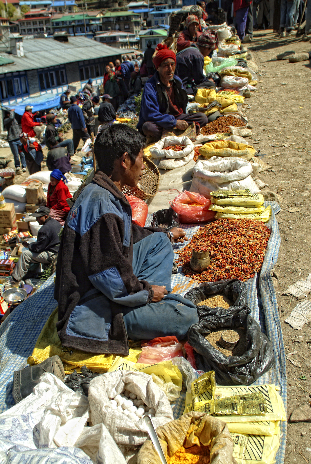 Farmers selling grain and produce at the Saturday market in Namche Bazaar, Nepal.  Image by New Orleans based travel photographer, Marc Pagani - marcpagani.com