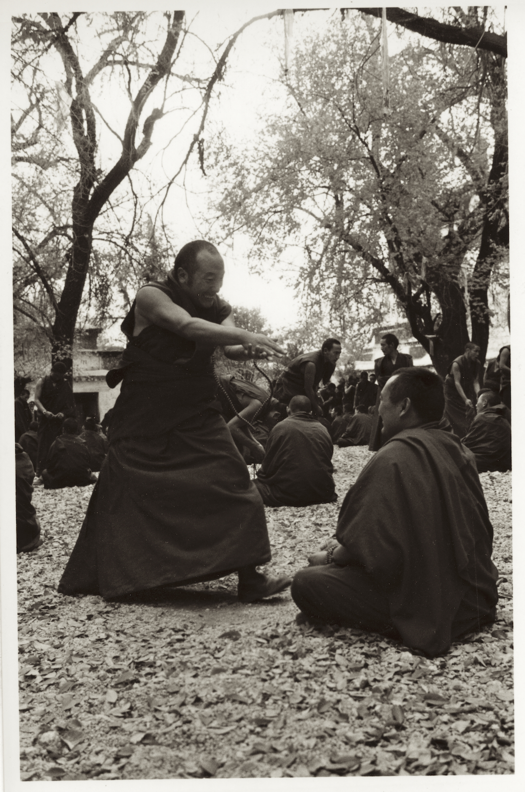 Monks debate at Sera Monastery in Tibet.  Image by New Orleans based travel photographer, Marc Pagani - marcpagani.com