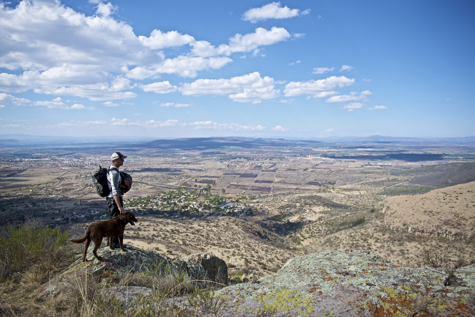 Tom and his dog above San Miguel d'Allende, Mexico.  Image by New Orleans based travel photographer, Marc Pagani