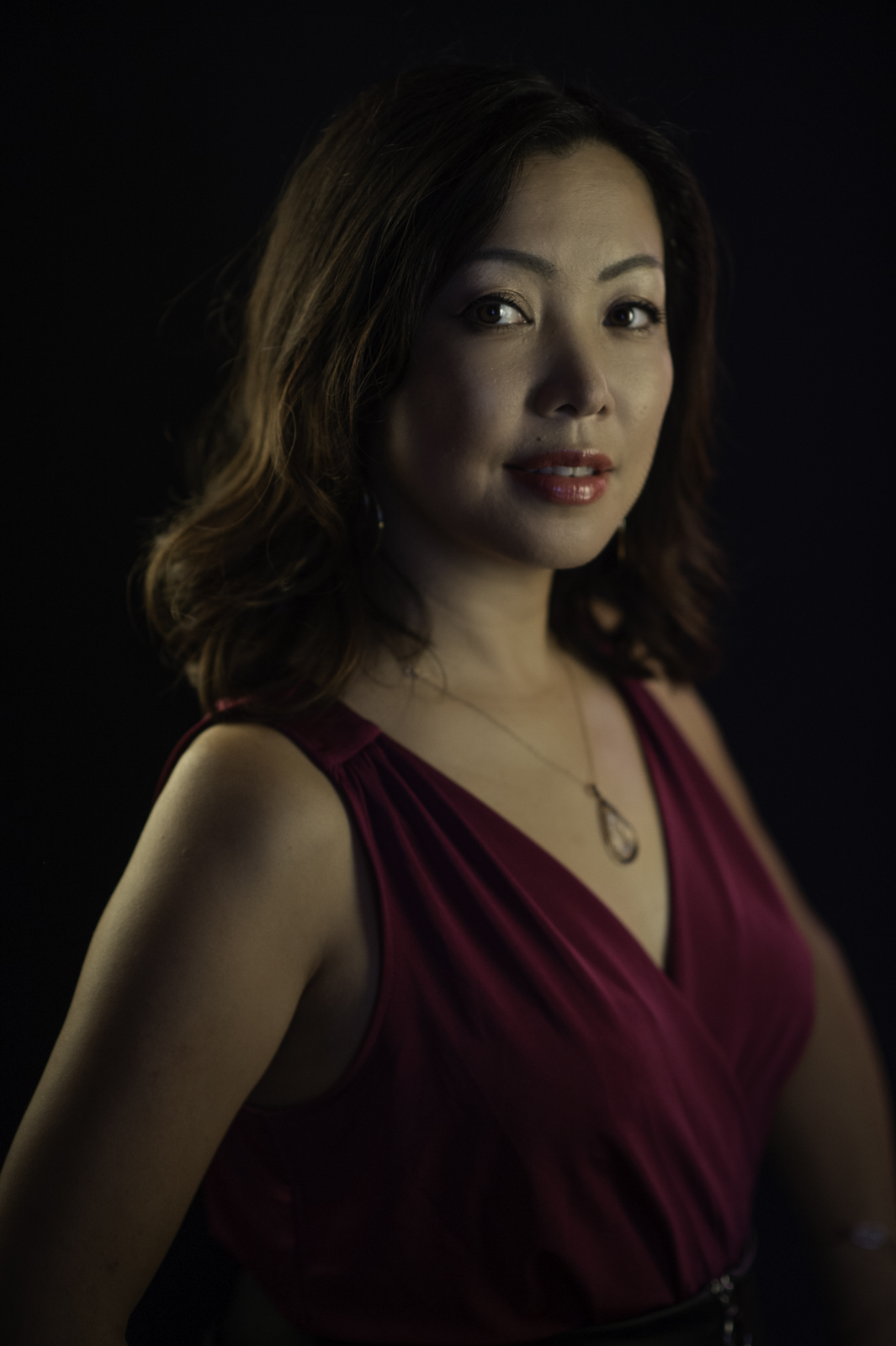 A studio portrait headshot of Keiko Komaki.  Image by New Orleans based portrait photographer, Marc Pagani