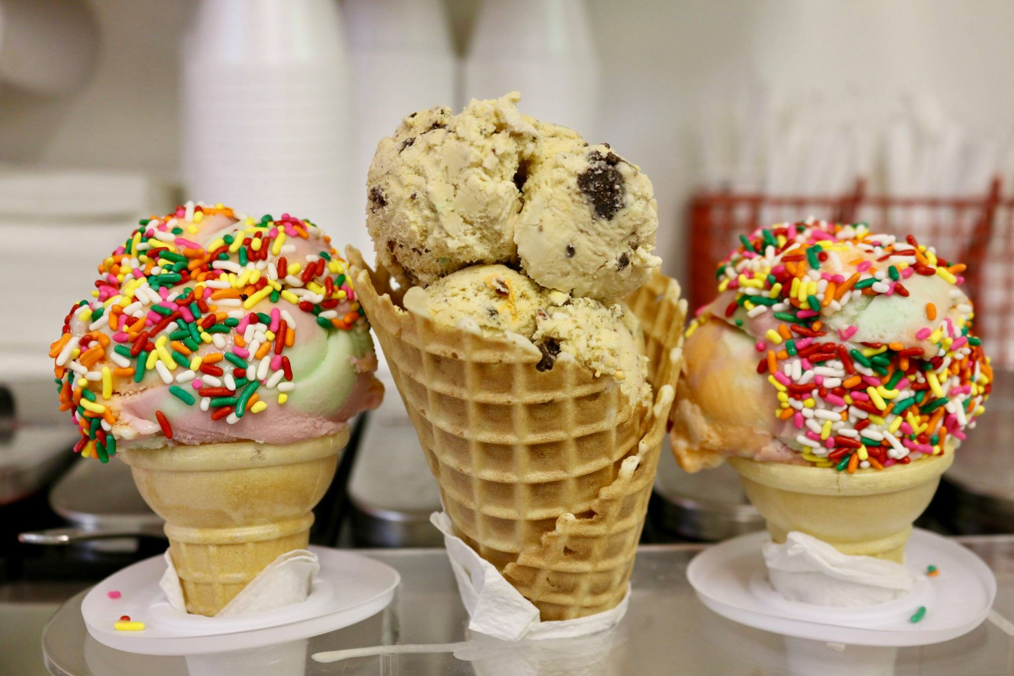 Pictured: Dipped ice cream in cake cones and waffle cones with rainbow sprinkles