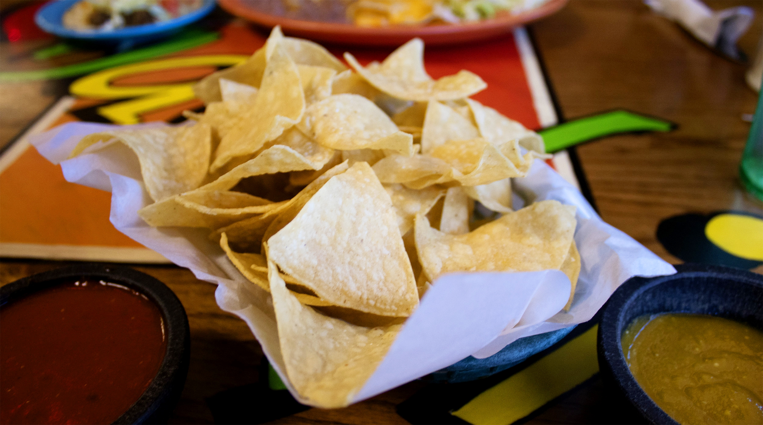 FREE COMPLEMENTARY FIRST BASKET OF OUR HOUSE TOSTADA CHIPS WITH RED AND GREEN SALSA