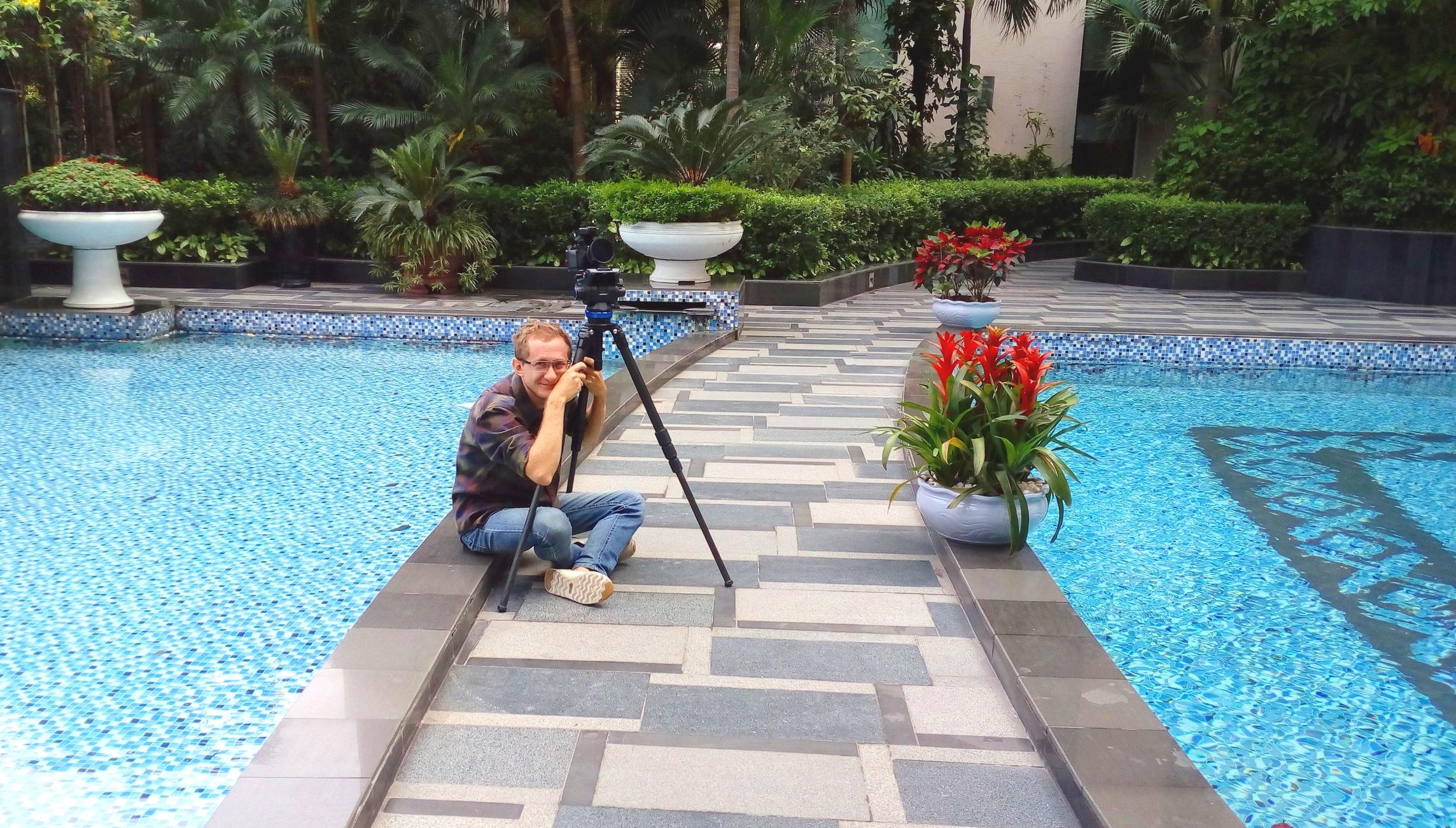Artem Ensuring Best Light for the Shot