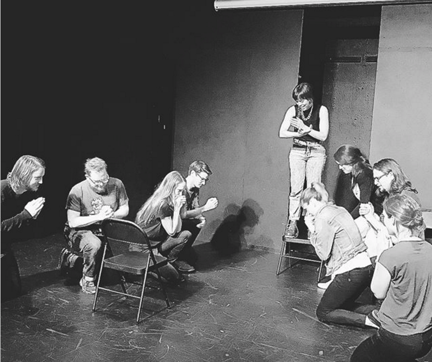 The Honey's mourn as their pastor leads them in a funeral dirge. From left to right: Nick Nelson, David Chalk, Lily Conboy, Nate Deakers, Maggie Beasley, Molly Weibe, Bri Cala, Kollin Holtz, & Cat Hollander. Photo credit to  Andrew Feldman and his Instagram .