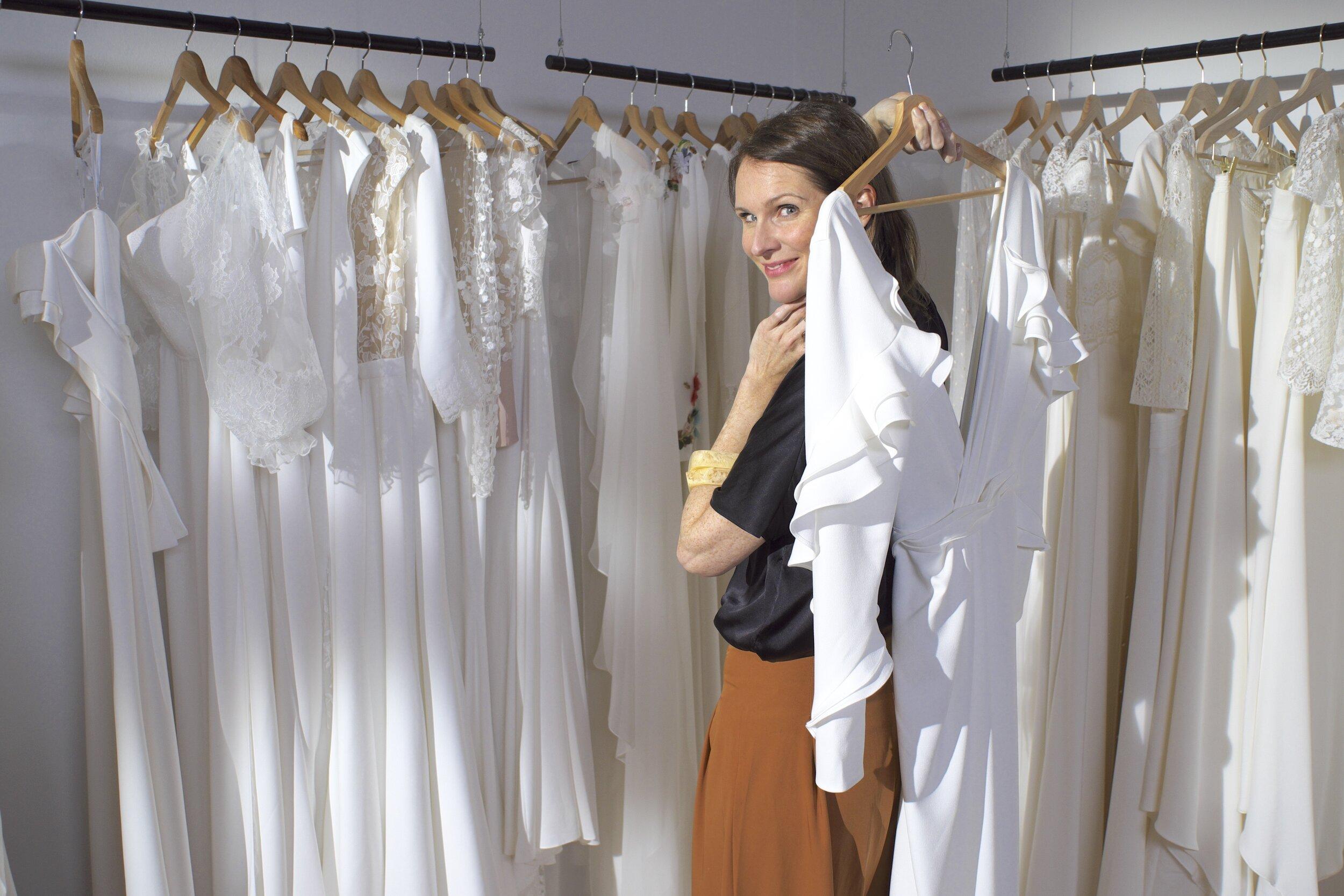 Zoe with Dresses.JPG