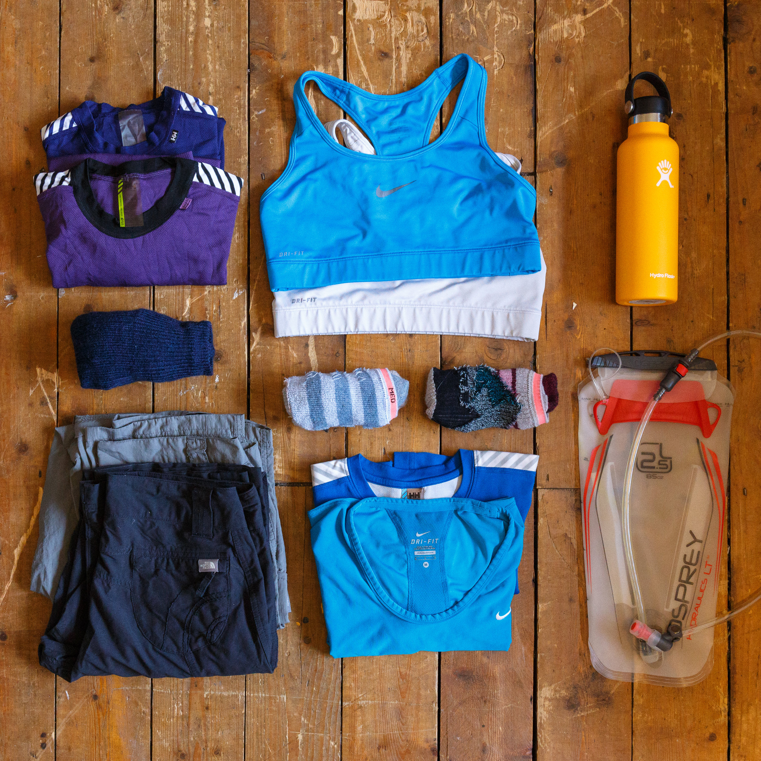 Left to Right: Helly Hansen Baselayers, Nike Sports Bras, Hydro-Flask, RMBLR Kinder socks, Stance Socks x 2, Osprey Hydration Pack, Mountain Warehouse and North Face walking trousers, Helly Hansen t-shirt and NIKE t-shirt