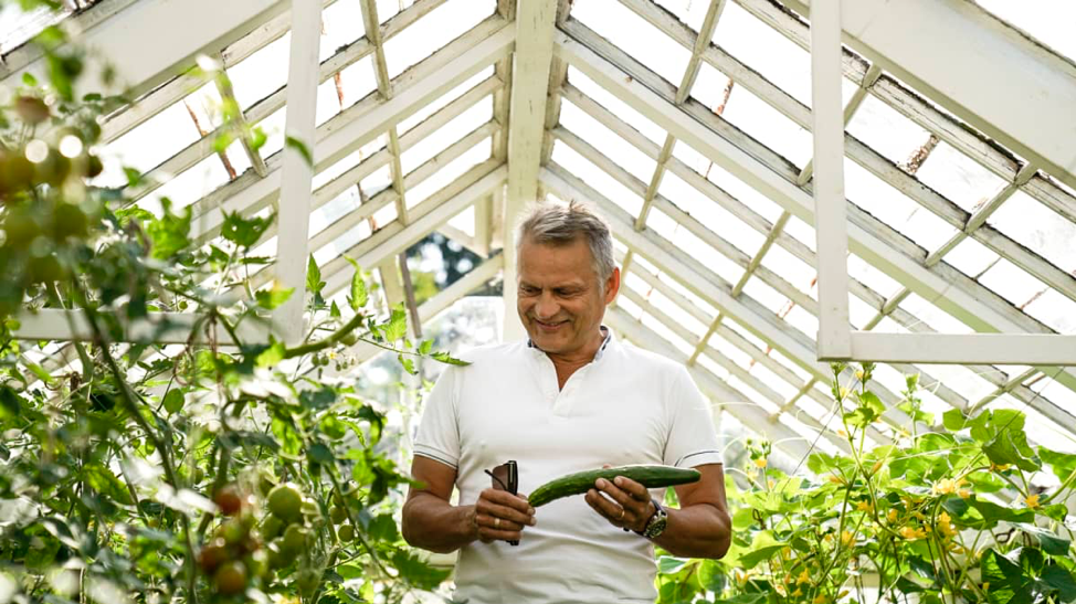 Futurist Markku Wilenius in his greenhouse. Sustainable development is important to Wilenius, which is why he grows his own food.