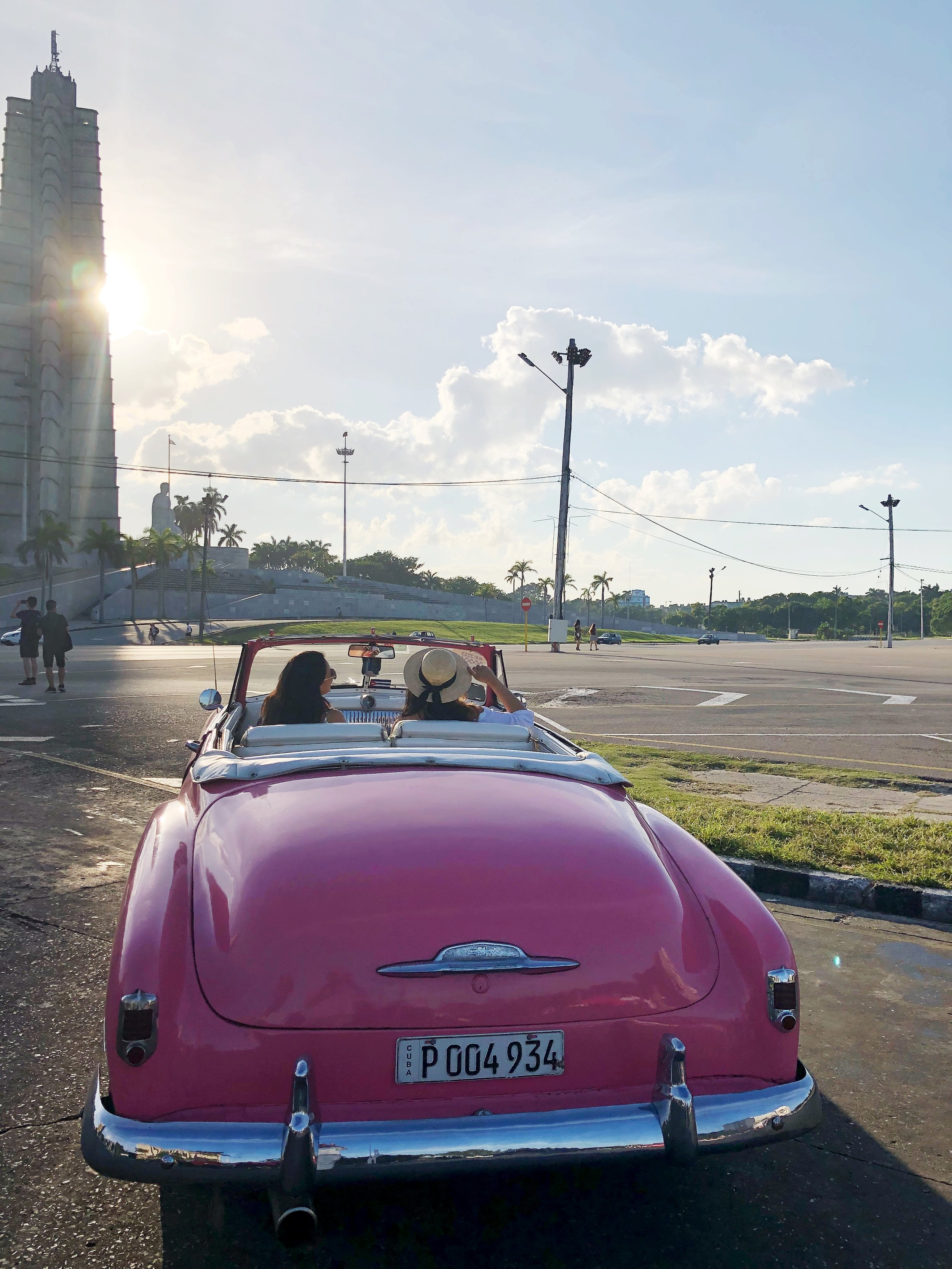 In our pink classic convertible