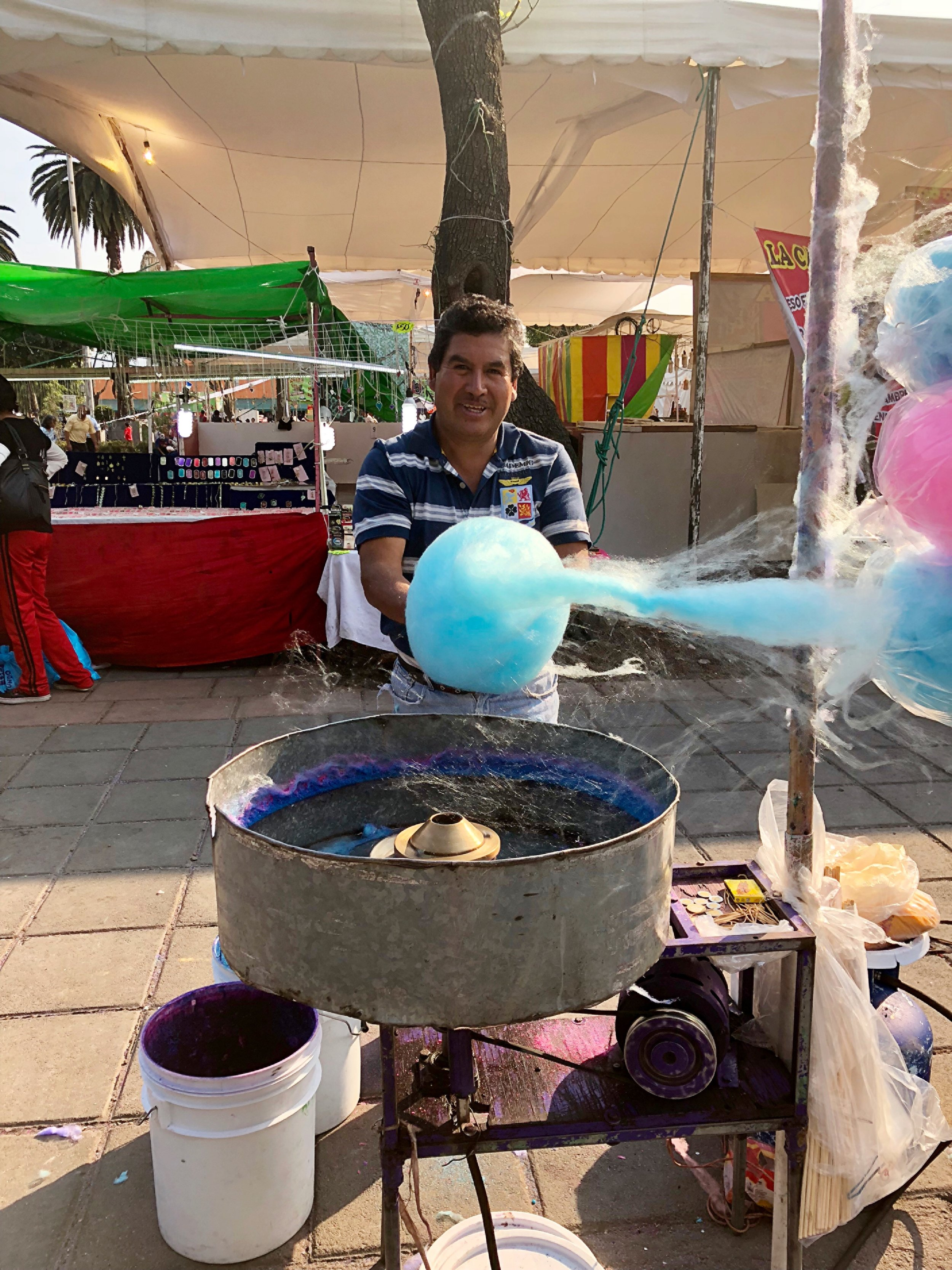 A local making my yummy cotton candy at Xochimilco's  Carnaval celebration