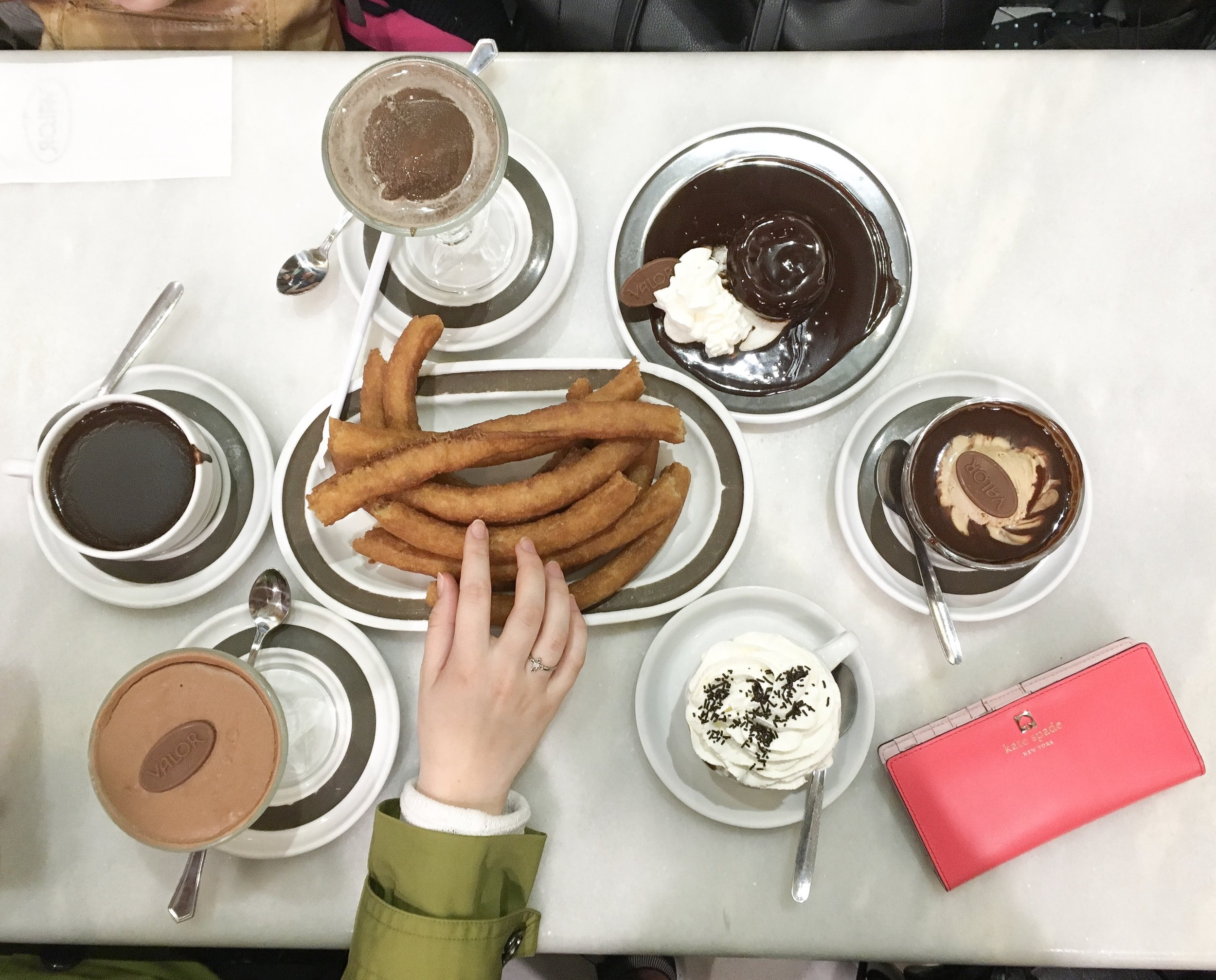 Getting churros con chocolate was a thing my friends and I loved doing— we would order a portion and share amongst ourselves
