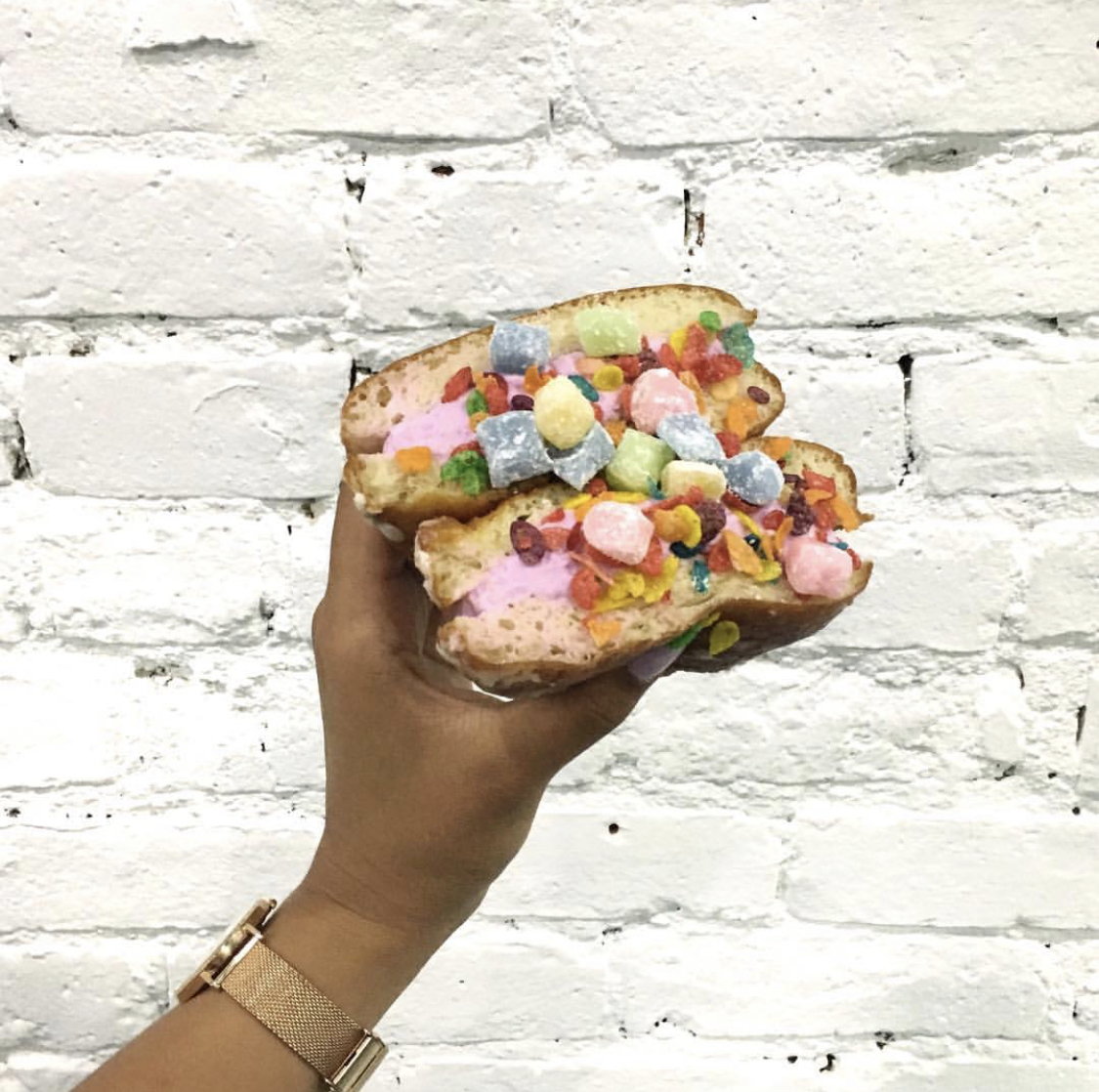 White Chocolate Lavender ice cream stuffed into a donut and topped off with mochi and fruity pebbles