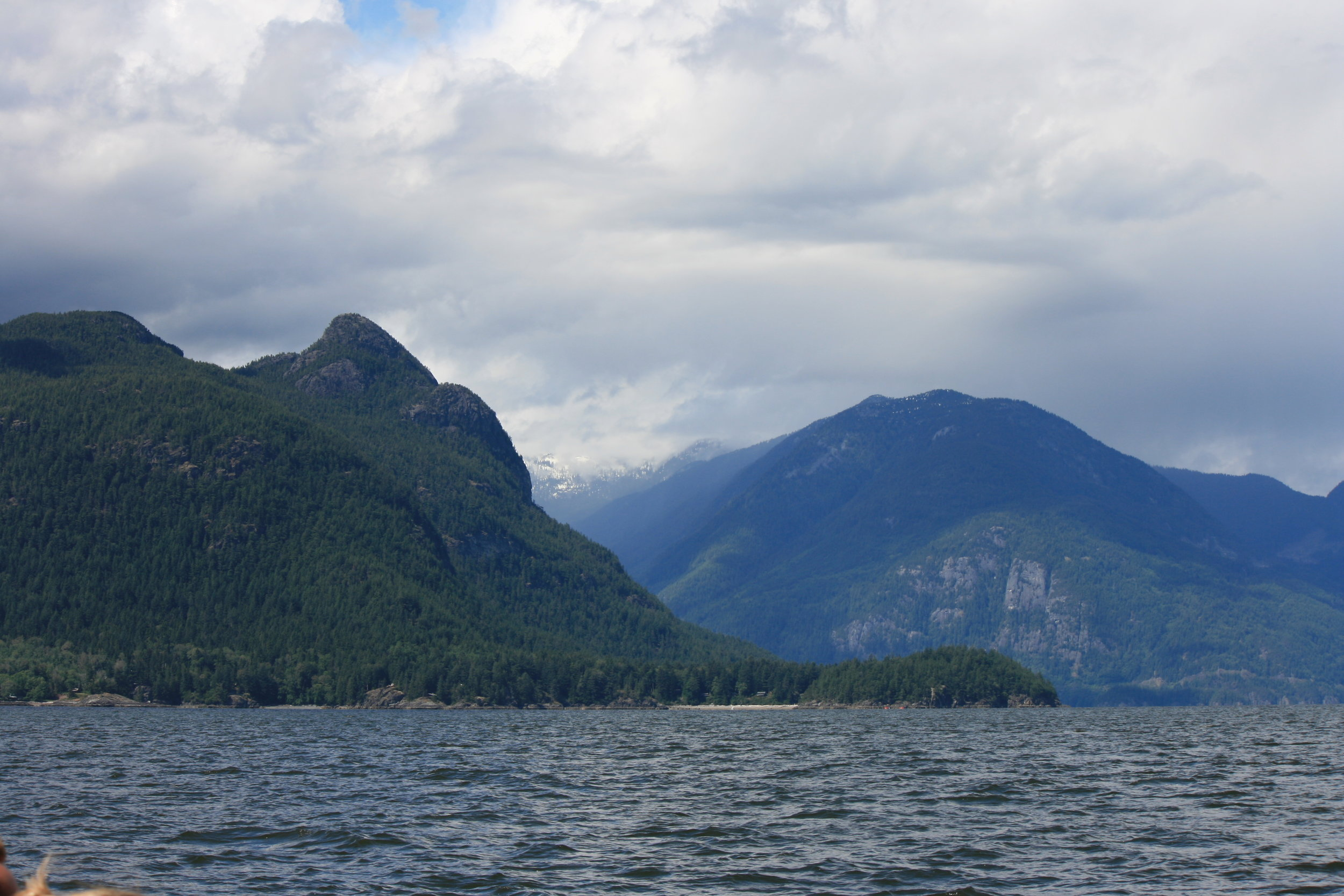 Howe Sound with the Coastal Mountains peaking through the clouds in the background. It's hard to imagine what the area would have looked like before being shaped by the glaciers! Photo by James Clyburn.