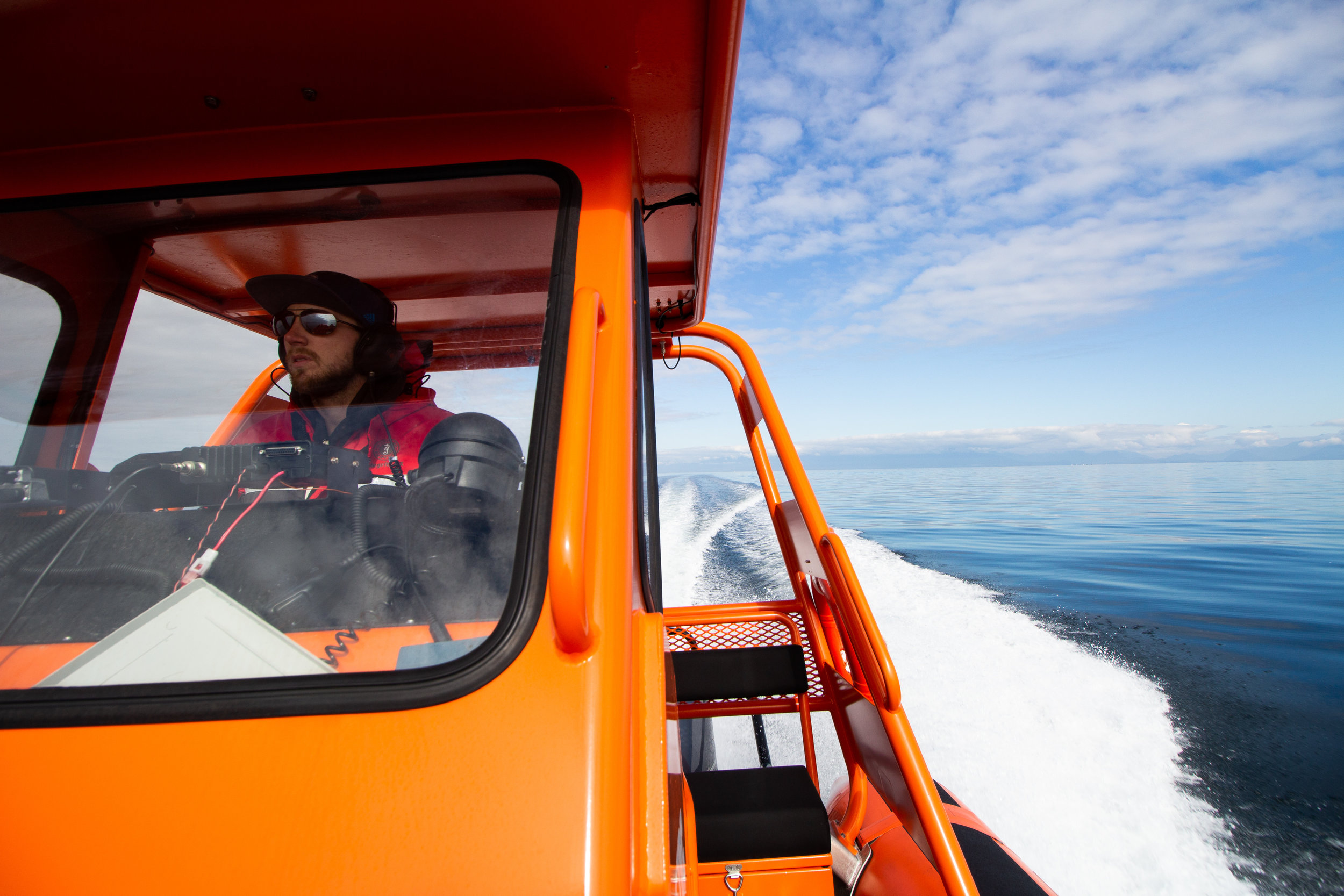 Captain James at the helm. Photo by Natalie Reichenbacher