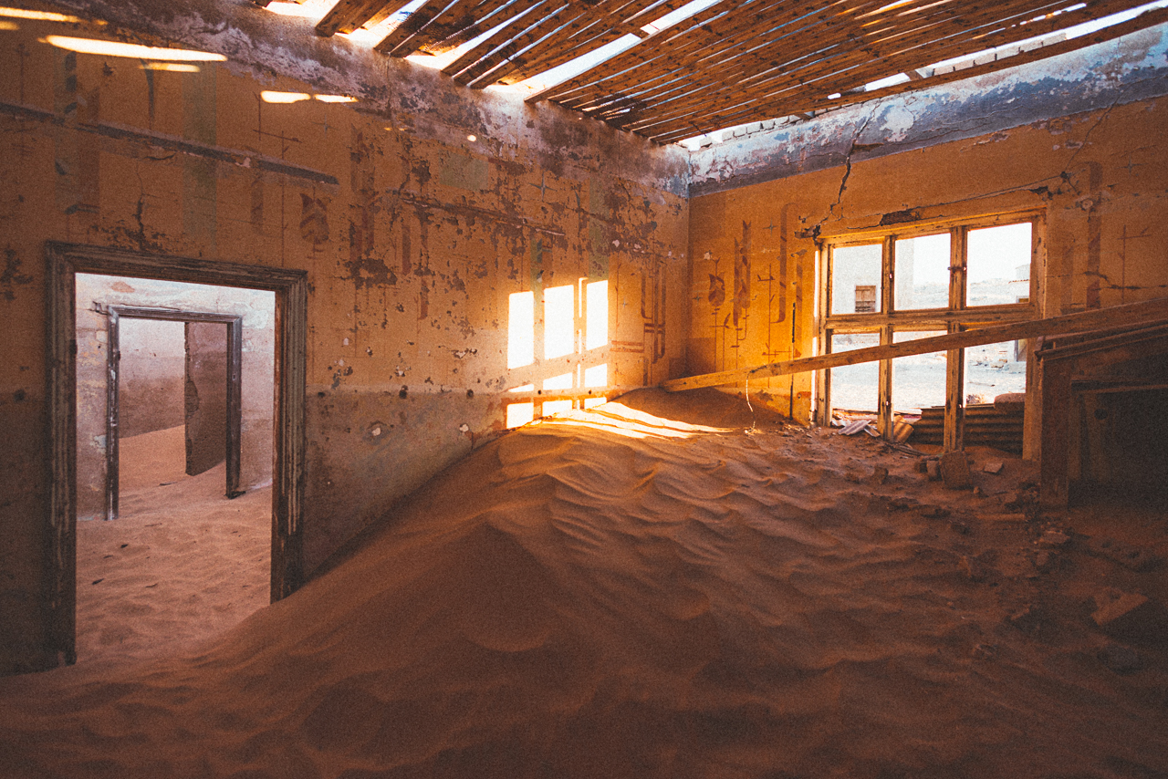 Kolmanskop. This is an abandoned mining town which has been overtaken by the sand