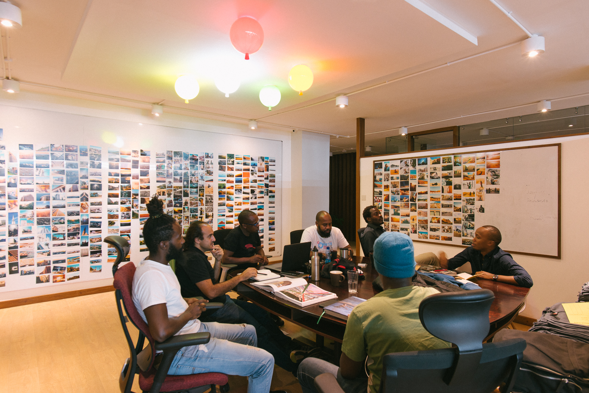 Meeting with the team working on the photography book. The Ark Africa team and the writer who is working to bring the stories to life in the book.