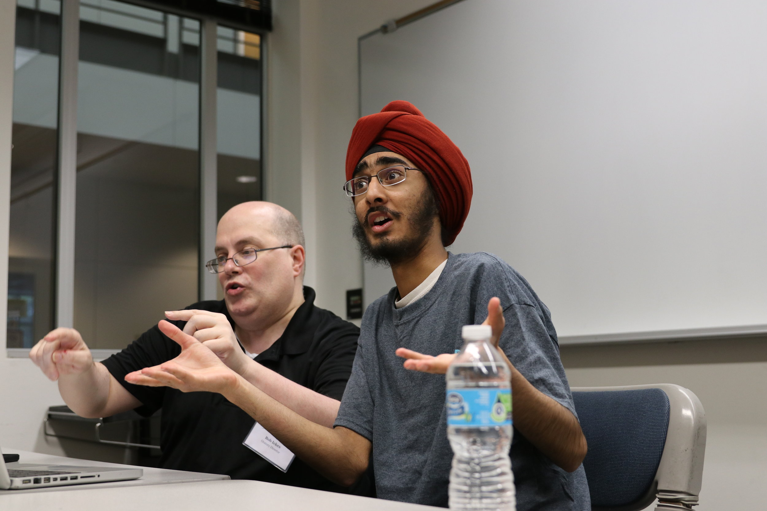 Summit Debate Online instructor  Bob Ickes  working with with 2017 NSDA Original Oratory National Champion JJ Singh Kapur at our summer institute in Iowa.