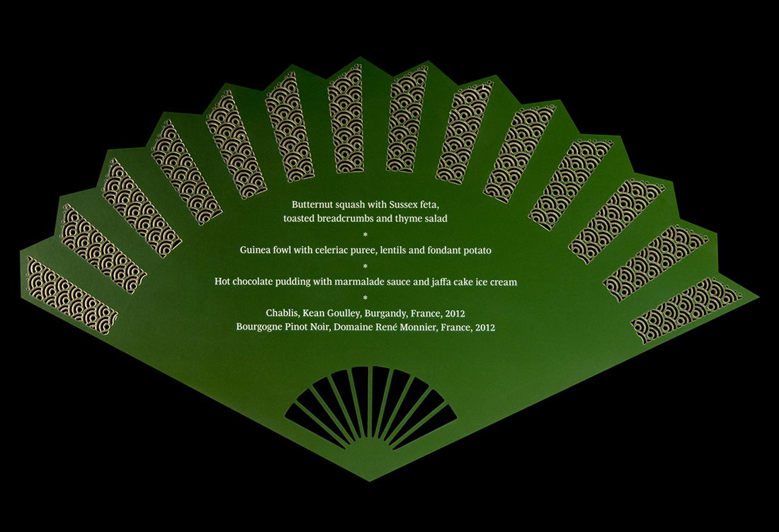 Laser-cut oriental fan menu for Madama Butterfly dinner at the Royal Opera House. Back.