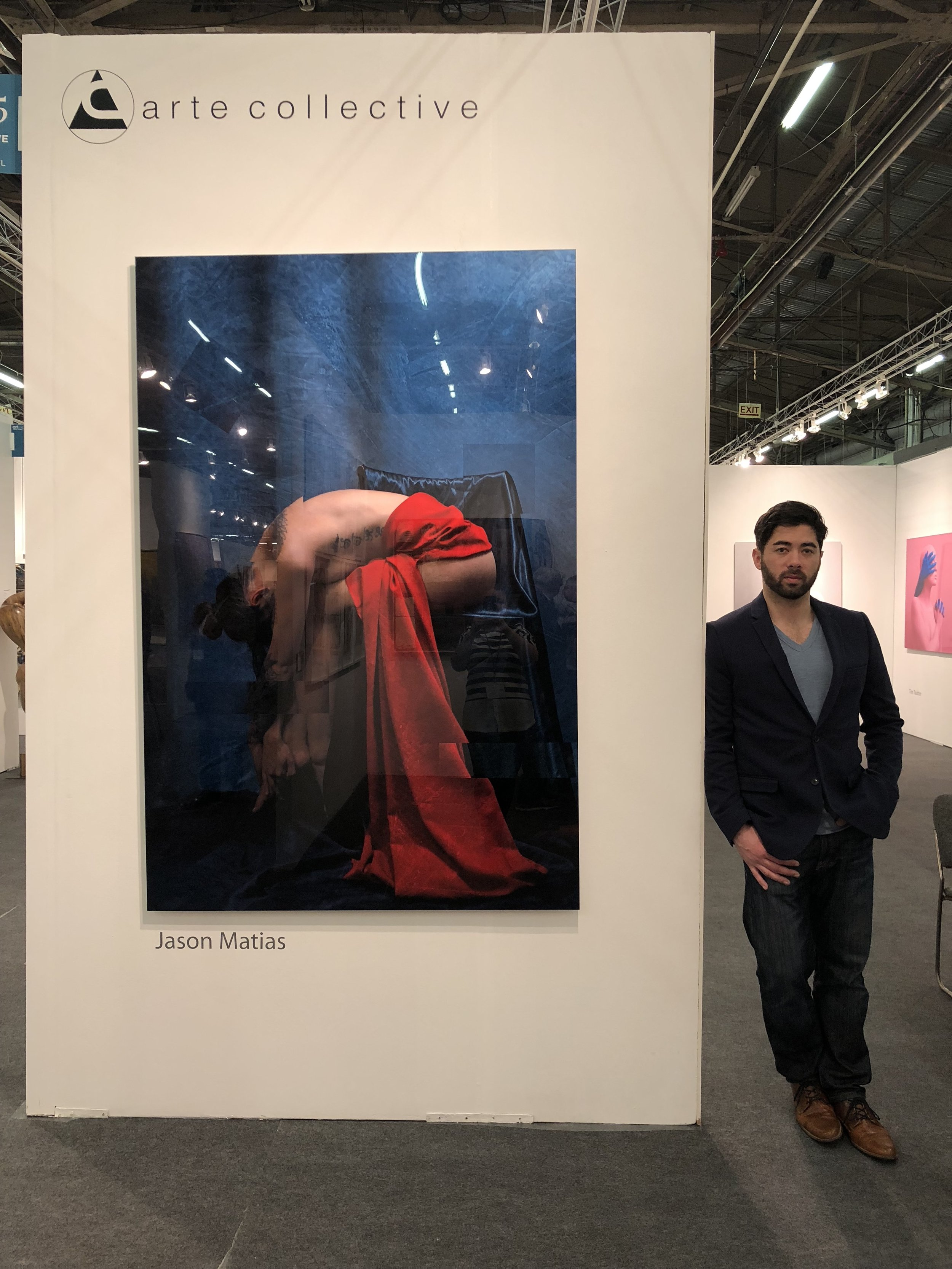 Jason Matias, artist, with Aria, the first nude in the collection.